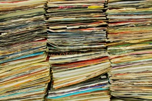 4310115-864342-three-stacks-of-old-comic-book-magazines-at-a-flea